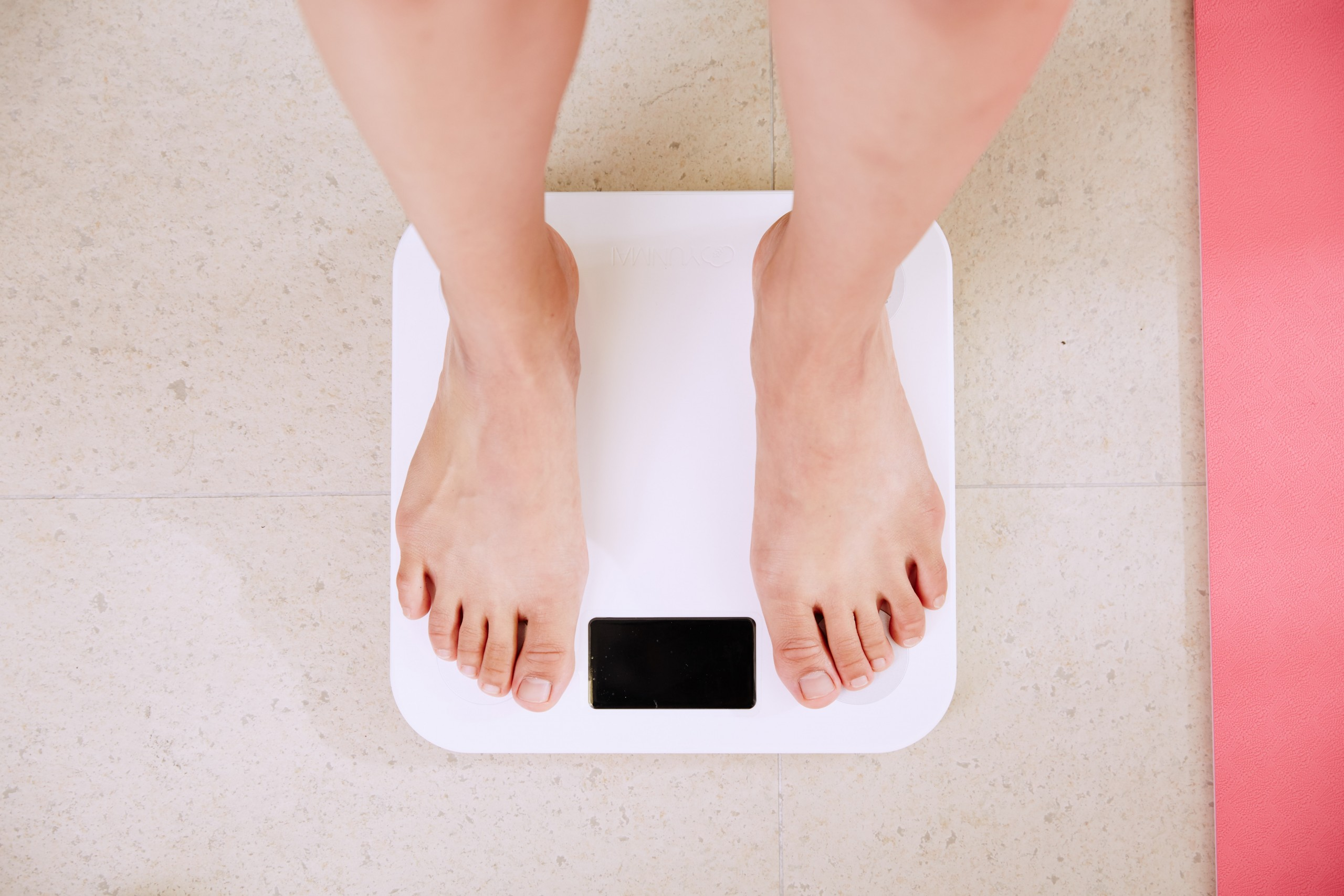 woman standing on a scale taking her weight